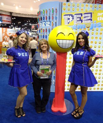 A giant pez, two pez girls and a PHOTY walk into the Sweets and Snacks Expo...